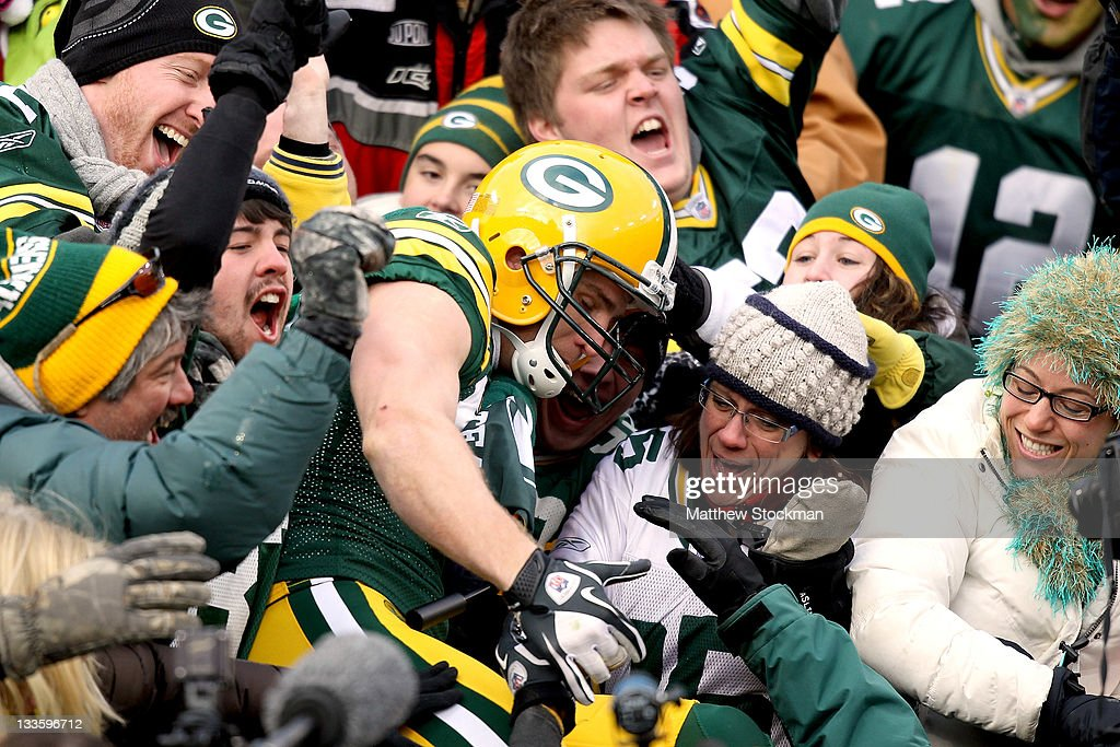 Jordy Nelson of the Green Bay Packers leaps into the bleachers after scoring a touchdown against the Tampa Bay Buccaneers at Lambeau Field on...