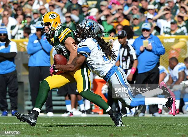Jordy Nelson of the Green Bay Packers makes a catch for a first down in front of Rashean Mathis of the Detroit Lions at Lambeau Field on October 6...