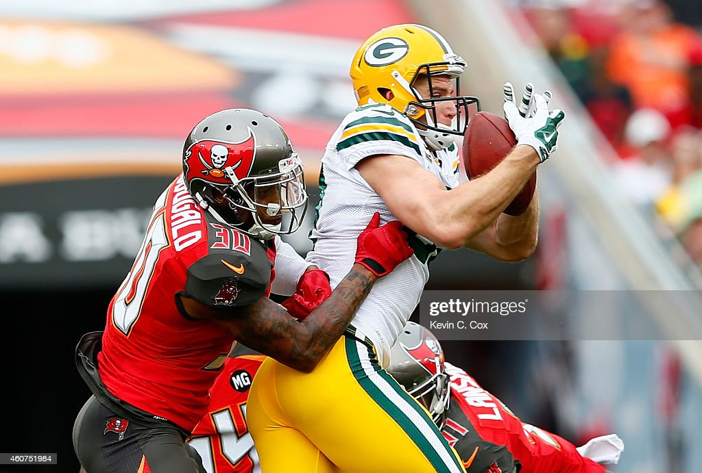 Jordy Nelson #87 of the Green Bay Packers pulls in this reception against Bradley McDougald #30, Lavonte David #54 of the Tampa Bay Buccaneers, and Danny Lansanah #51 of the Tampa Bay Buccaneers at Raymond James Stadium on December 21, 2014 in Tampa, Florida.