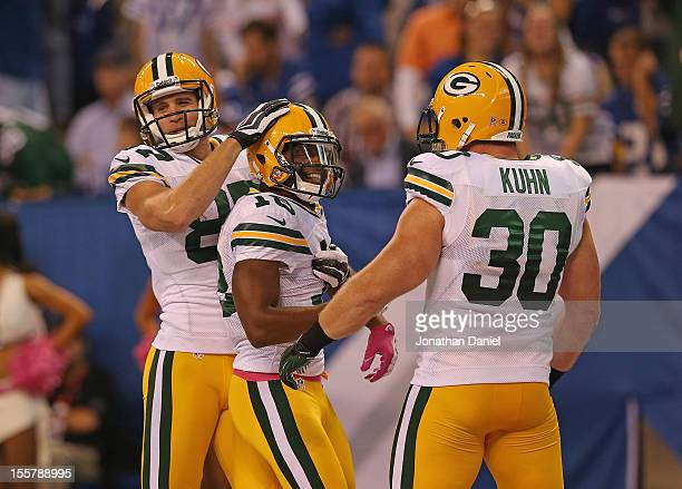 Jordy Nelson Randall Cobb and John Kuhn of the Green Bay Packers celebrate a touchdown by Cobb against the Indianapolis Colts at Lucas Oil Stadium on...