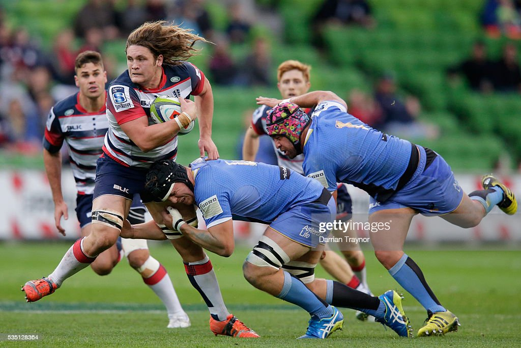 Jordy Reid of the Rebels breaks a tackle during the round 14 Super Rugby match between the Rebels and the Force at AAMI Park on May 29, 2016 in Melbourne, Australia.