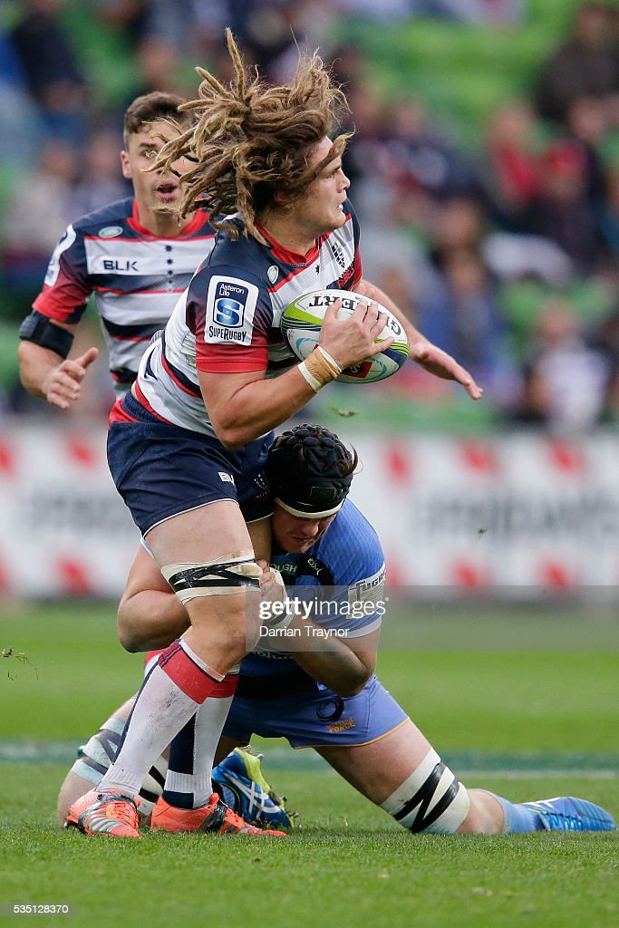 Jordy Reid of the Rebels is tackled during the round 14 Super Rugby match between the Rebels and the Force at AAMI Park on May 29, 2016 in Melbourne, Australia.