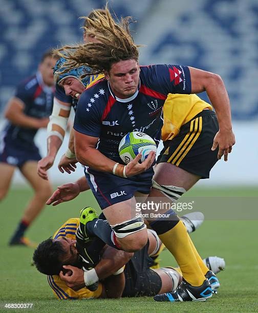 Jordy Reid of the Rebels is tackled during the Super Rugby trial match between the Rebels and the Hurricanes at Simonds Stadium on February 8 2014 in...