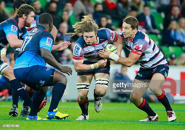 Jordy Reid of the Rebels runs with the ball during the round 17 Super Rugby match between the Rebels and the Bulls at AAMI Park on June 6 2015 in...
