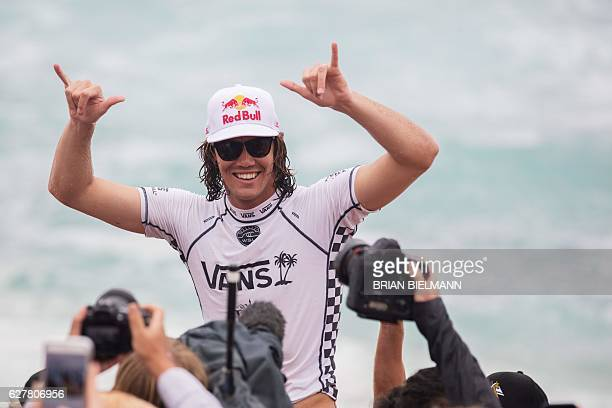 Jordy Smith of South Africa celebrate his win in the 2016 Vans World Cup surfing event at Sunset Beach Hawai on December 4 2016 The Championship Tour...