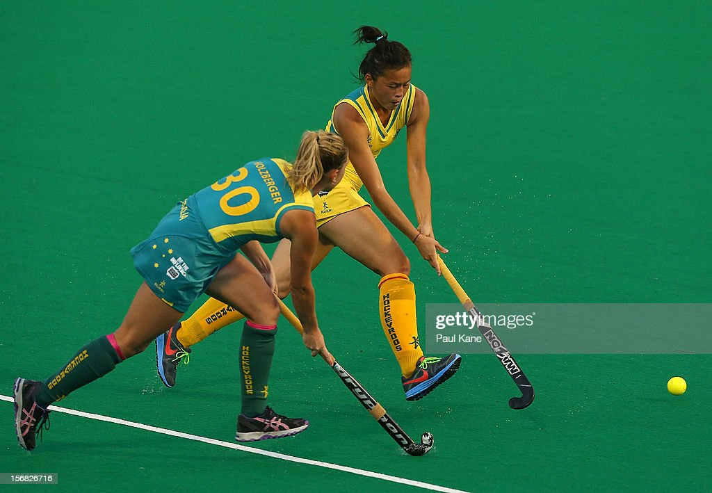 Jordyn Holzberger of the Jillaroos and Kary Chau of the Hockeyroos contest for the ball during the womens Australia v Australia under 21 game on day one of the 2012 International Super Series at Perth Hockey Stadium on November 22, 2012 in Perth, Australia.