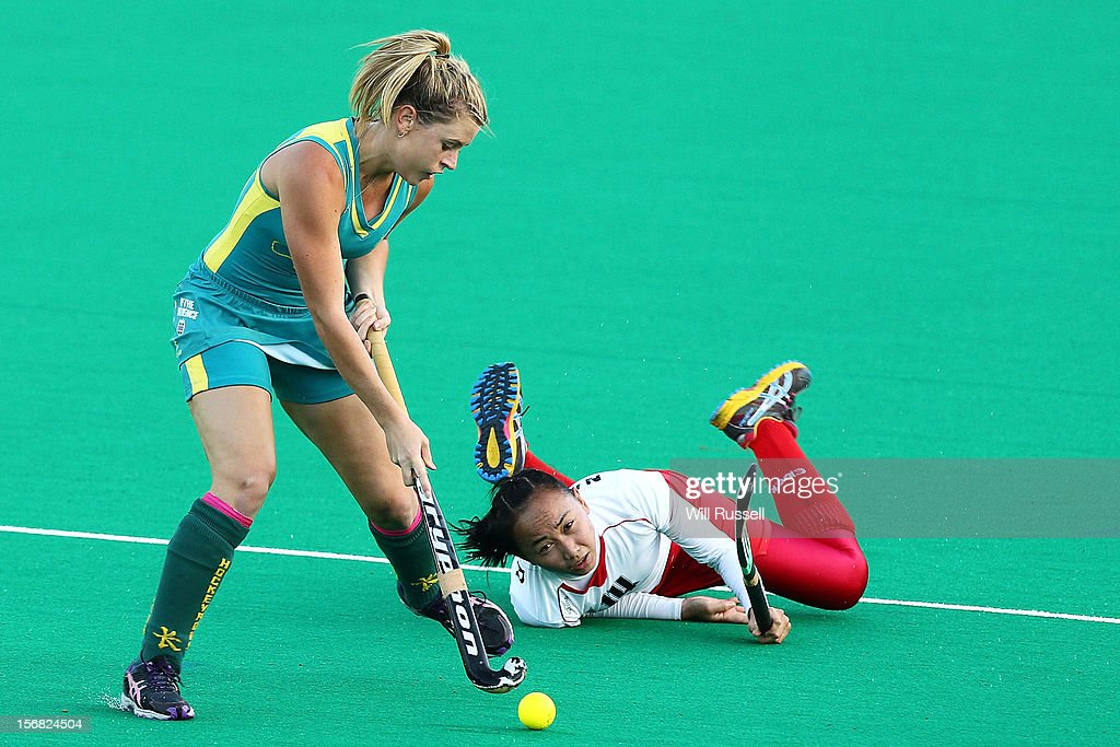 Jordyn Holzberger of the Jillaroos challenges Nadia Abd Rahman of Malaysia during day one of the 2012 International Super Series at Perth Hockey Stadium on November 22, 2012 in Perth, Australia.