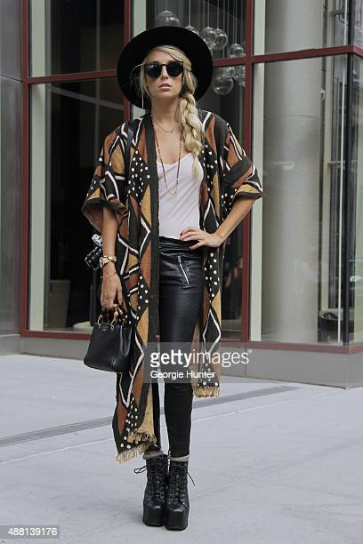 Jordyn Kraemer is seen on the streets of Manhattan outside of the Lie Sangbong Spring 2016 fashion show at Skylight at Moynihan Station wearing black...