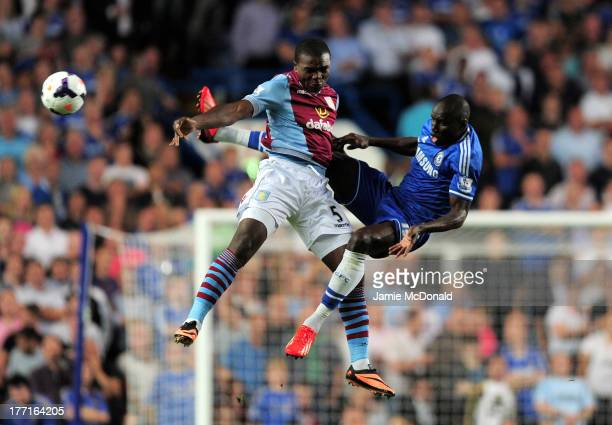 Jores Okore of Aston Villa and Demba Ba of Chelsea compete for the ball during the Barclays Premier League match between Chelsea and Aston Villa at...