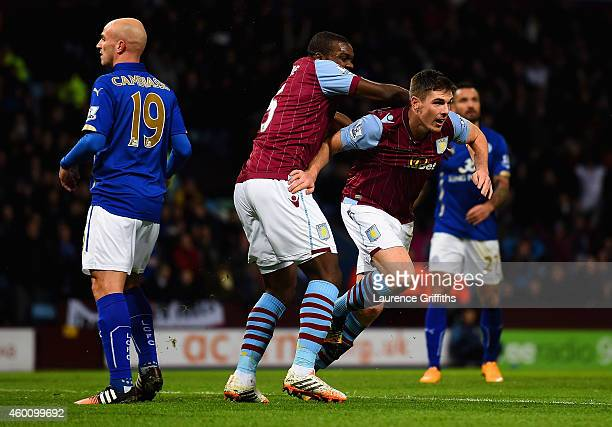 Jores Okore of Aston Villa congratulates Ciaran Clark of Aston Villa as he turns to celebrate scoring their first goal during the Barclays Premier...