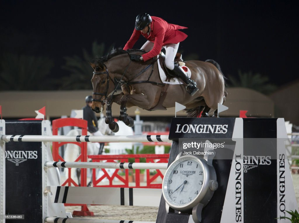 Jorg Naeve of Germany clears a hurdle on Calado 2 during the President of the UAE Showjumping Cup - Furusyiah Nations Cup Series presented by Longines on February 21, 2013 in Al Ain, United Arab Emirates.