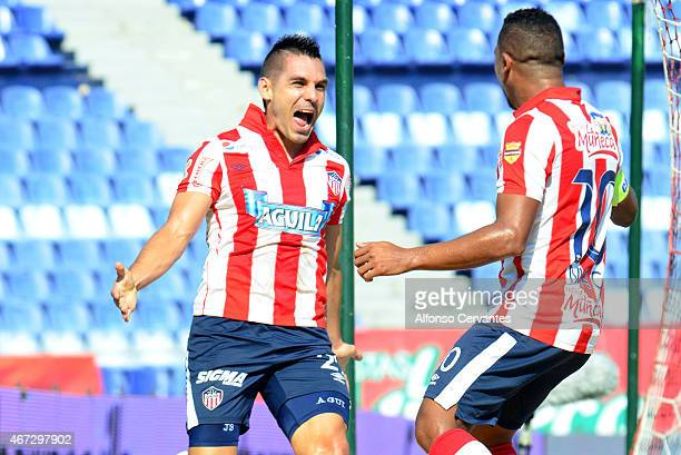 Jorge Aguirre and Macnelly Torres of Junior celebrate the first goal of his team during a match between Junior and Millonarios as part of 11th round...