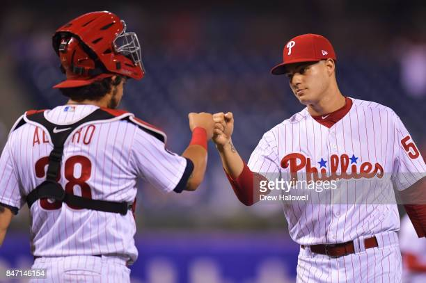 Jorge Alfaro and Yacksel Rios of the Philadelphia Phillies celebrate after beating the Miami Marlins 100 at Citizens Bank Park on September 14 2017...