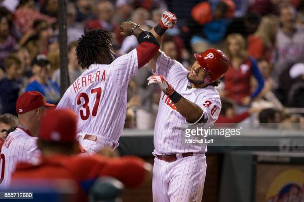 Jorge Alfaro of the Philadelphia Phillies celebrates with Odubel Herrera after hitting a solo home run in the bottom of the sixth inning against the...