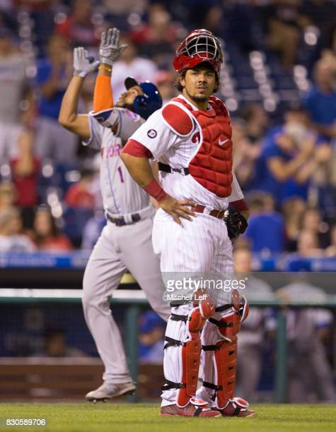 Jorge Alfaro of the Philadelphia Phillies looks on as Amed Rosario of the New York Mets celebrates his solo home run in the top of the ninth inning...