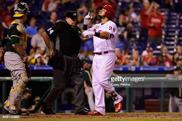 Jorge Alfaro of the Philadelphia Phillies points skyward after his tworun homer against the Oakland Athletics during the sixth inning at Citizens...