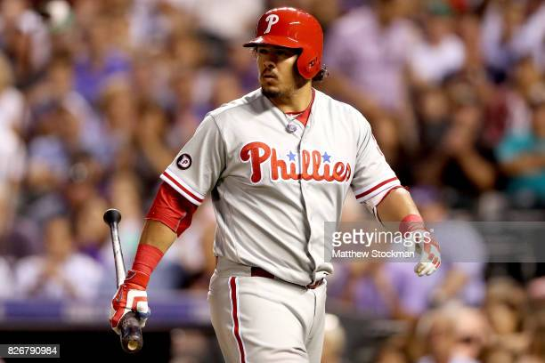 Jorge Alfaro of the Phliadelphia Phillies walks back to the dugout in the seventh inning against the Colorado Rockies at Coors Field on August 5 2017...