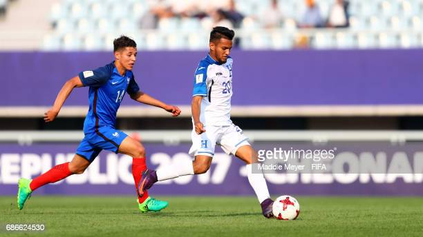 Jorge Alvarez of Honduras dribbles past Amine Harit of France during the FIFA U20 World Cup Korea Republic 2017 group E match between France and...