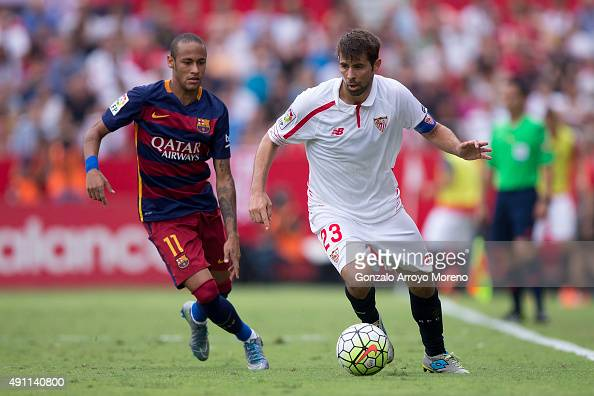 Jorge Andujar Moreno alias Coke of Sevilla FC competes for the ball with Neymar JR of FC Barcelona during the La Liga match between Sevilla FC and FC...