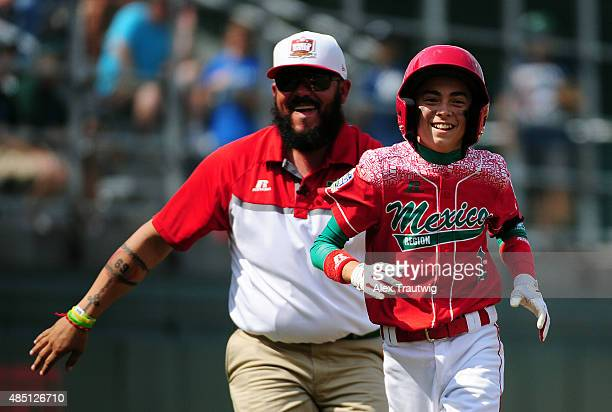 Jorge Armenta of the Mexico team celebrates after hitting a home run against the Australia team at Volunteer Stadium during Game 17 of the Little...