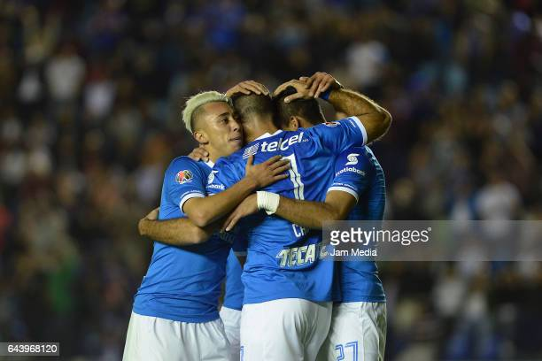 Jorge Benitez of Cruz Azul celebrates after scoring the third goal of his team with teammates Martin Rodriguez and Martin Cauteruccio during the...