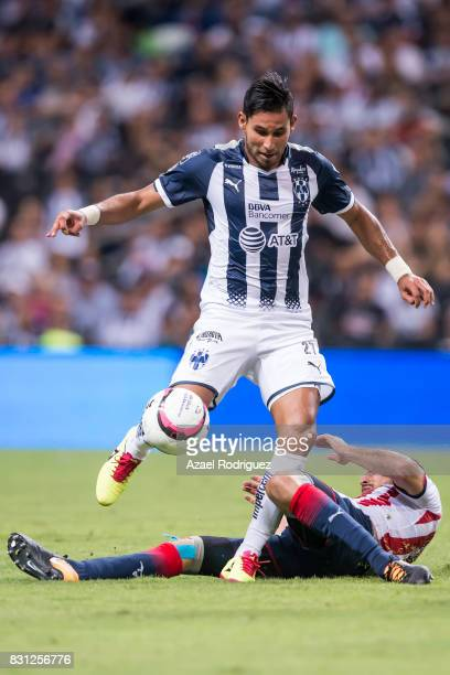 Jorge Benitez of Monterrey fights for the ball with Jesus Sanchez of Chivas during the 4th round match between Monterrey and Chivas as part of the...