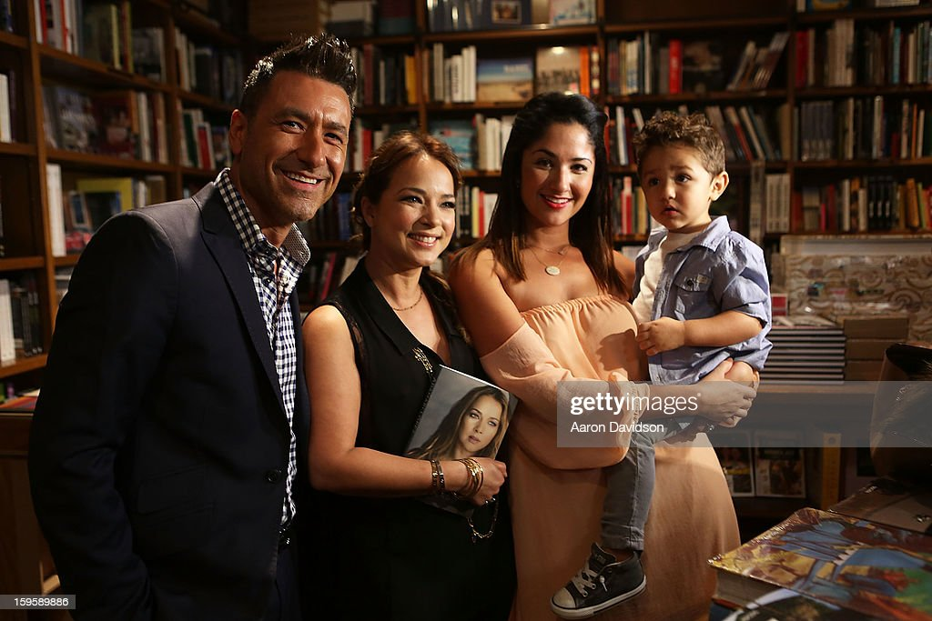 Jorge Bernal, <a gi-track='captionPersonalityLinkClicked' href=/galleries/search?phrase=Adamari+Lopez&family=editorial&specificpeople=2550892 ng-click='$event.stopPropagation()'>Adamari Lopez</a>, Karla Birbragher and Lucas Daniel Bernal greets fans and signs copies of her book 'Viviendo' at Books and Books on January 16, 2013 in Coral Gables, Florida.