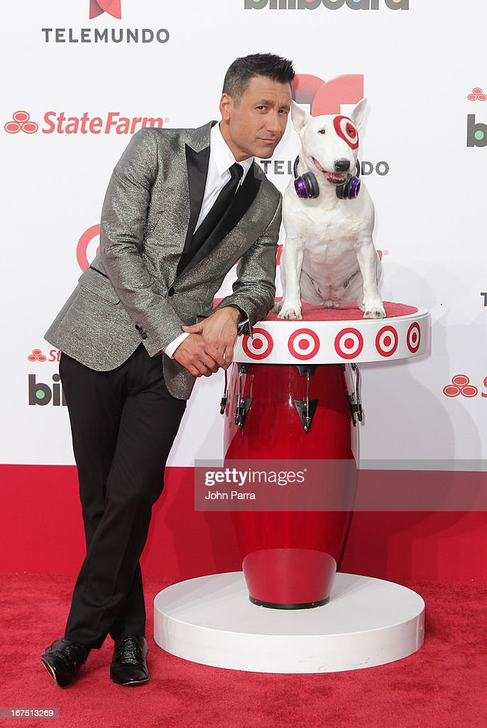 Jorge Bernal celebrates with Bullseye, Target's Beloved Bull Terrier Mascot, at the 2013 Billboard Latin Music Awards at BankUnited Center on April 25, 2013 in Miami, Florida.