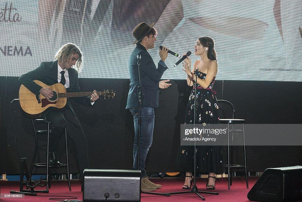 Jorge Blanco and Martina Stoessel sing a track of Tini during the premiere of Tini-La nuova vita di Violetta at Auditorium Parco della Musica on April, 29, 2016 in Rome, Italy.