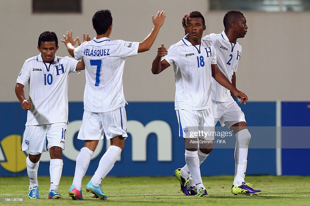 Jorge Bodden (2R) of Honduras celebrates his team's first goal with team mates Isaac Borjas, Brayan Velasquez and Kevin Alvarez (L-R) during the FIFA U-17 World Cup UAE 2013 Round of 16 match between Honduras and Uzbekistan at Sharjah Stadium on October 28, 2013 in Sharjah, United Arab Emirates.