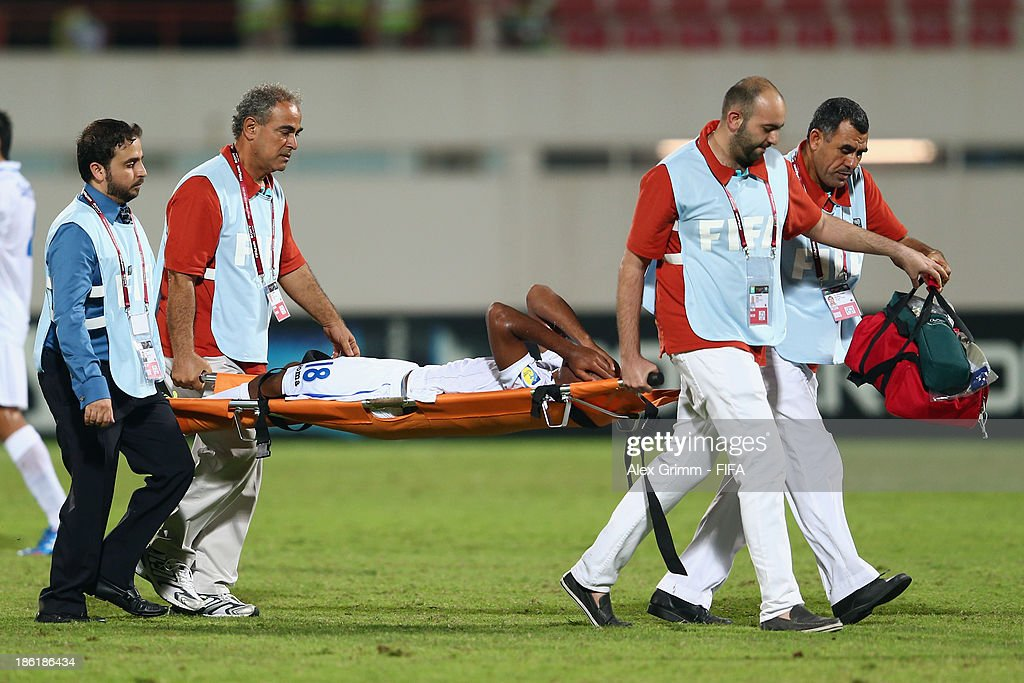 Jorge Bodden of Honduras is carried off the pitch on a stretcher by FIFA medical staff during the FIFA U-17 World Cup UAE 2013 Round of 16 match between Honduras and Uzbekistan at Sharjah Stadium on October 28, 2013 in Sharjah, United Arab Emirates.