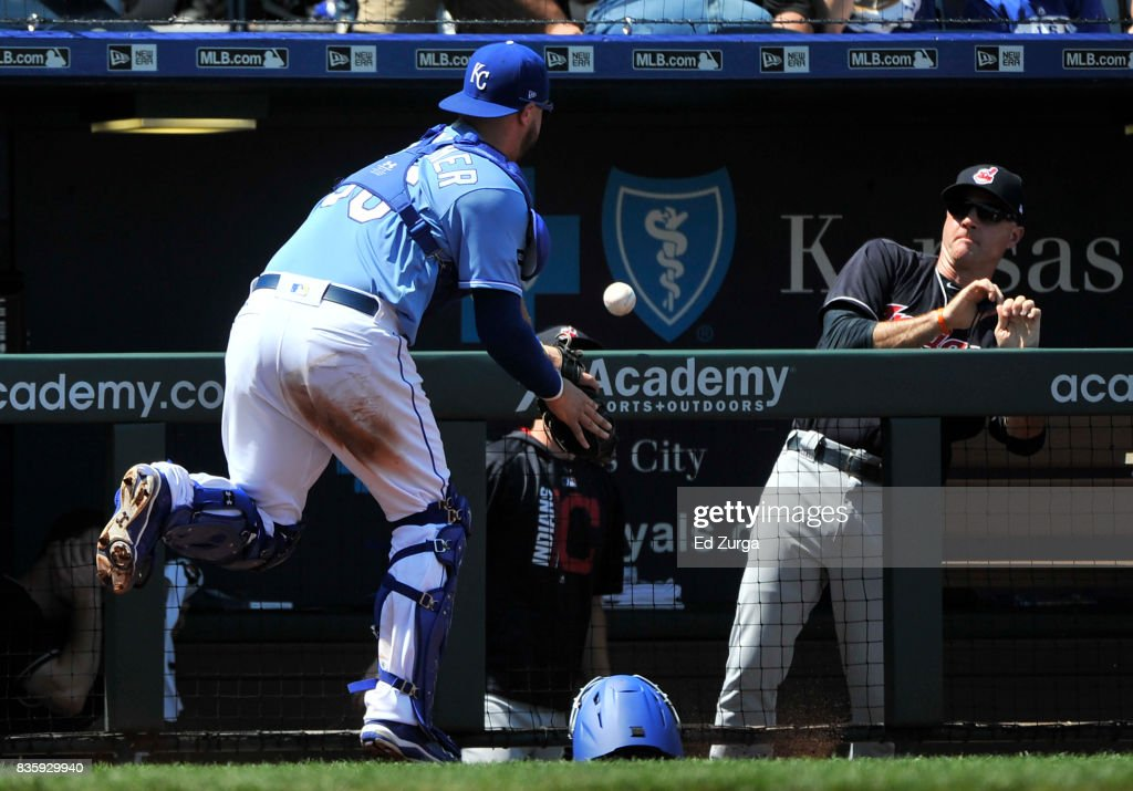 Jorge Bonifacio #38 of the Kansas City Royals can't catch a foul ball hit by Francisco Lindor #12 of the Cleveland Indians as Matt Quatraro #60 looks on at Kauffman Stadium on August 20, 2017 in Kansas City, Missouri.