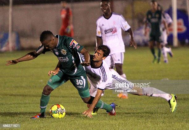 Jorge Brazalez of America of Cali struggles for the ball with Luis Moreno of Valledupar Futbol Club during a match between America of Cali and...