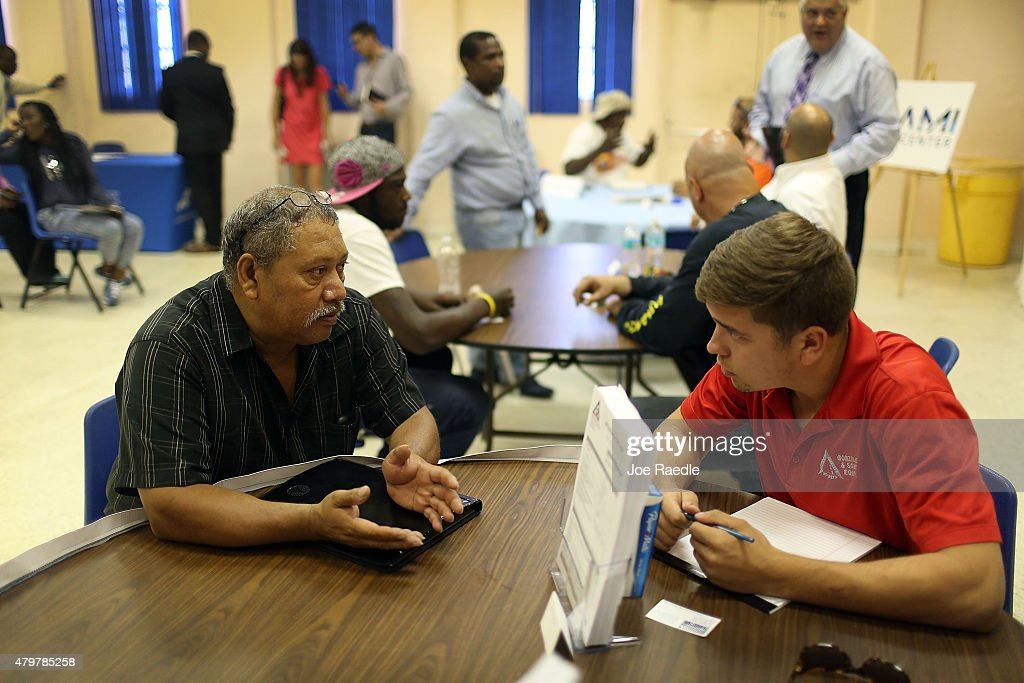Jorge Cajina speaks with recruiter David Rubio from Gonzalez and Son's inc as he is interviewd for a Job during the Miami Worldcenter construction...