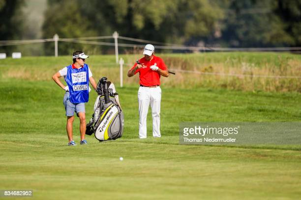 Jorge Campillo of Spain and his caddie are seen during day two of the Saltire Energy Paul Lawrie Matchplay at Golf Resort Bad Griesbach on August 18...