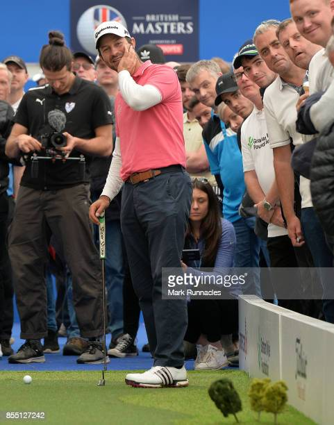 Jorge Campillo of Spain takes part in the Long Putt Challenge at the American Golf Show during the first day of the British Masters at Close House...