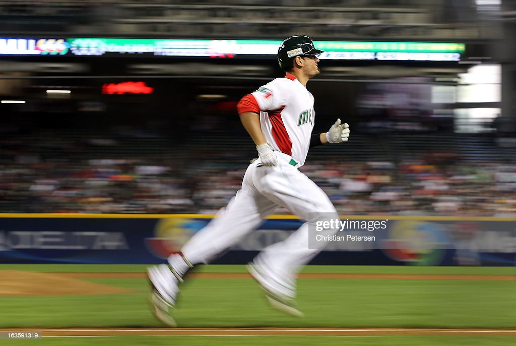 Jorge Cantu #3 of Mexico runs to first base on a ground ball out during the World Baseball Classic First Round Group D game against Canada at Chase Field on March 9, 2013 in Phoenix, Arizona.