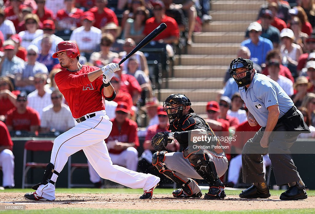 <a gi-track='captionPersonalityLinkClicked' href=/galleries/search?phrase=Jorge+Cantu&family=editorial&specificpeople=218045 ng-click='$event.stopPropagation()'>Jorge Cantu</a> #3 of the Los Angeles Angels of Anaheim bats against the San Francisco Giants during the spring training game at Tempe Diablo Stadium on March 10, 2012 in Tempe, Arizona.