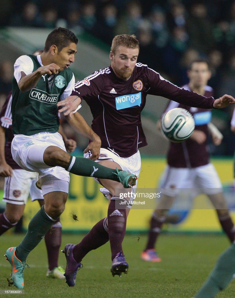 Jorge Carlos of Hibernian tackles Ryan Stevenson of Hearts during the Scottish Cup match between Hibernian and Hearts at Easter Road Stadium on December 2, 2012 in Edinburgh,Scotland.