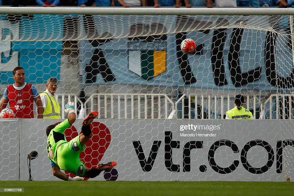 Jorge Carranza goalkeeper of O'Higgins fails to stop Fernando Manriquez of Universidad de Concepcion (not in frame) from scoring the second goal of his team during a match between O'Higgins and U de Concepcion as part of Torneo Clausura 2016 at El Teniente Stadium on April 30, 2016 in Rancagua, Chile.