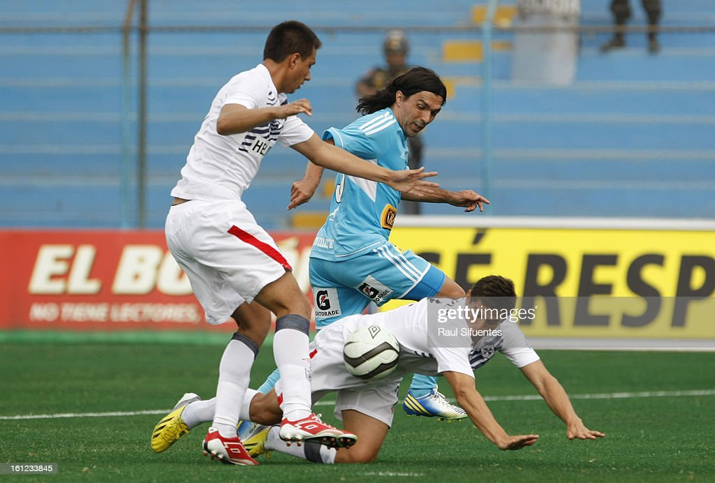 Jorge Cazulo of Sporting Cristal fights for the ball with Aldo Corzo of San Martin during a match between Sporting Cristal and San Martin as part of The 2013 Torneo Descentralizado at the Alberto Gallardo Stadium on February 09, 2013 in Lima, Peru