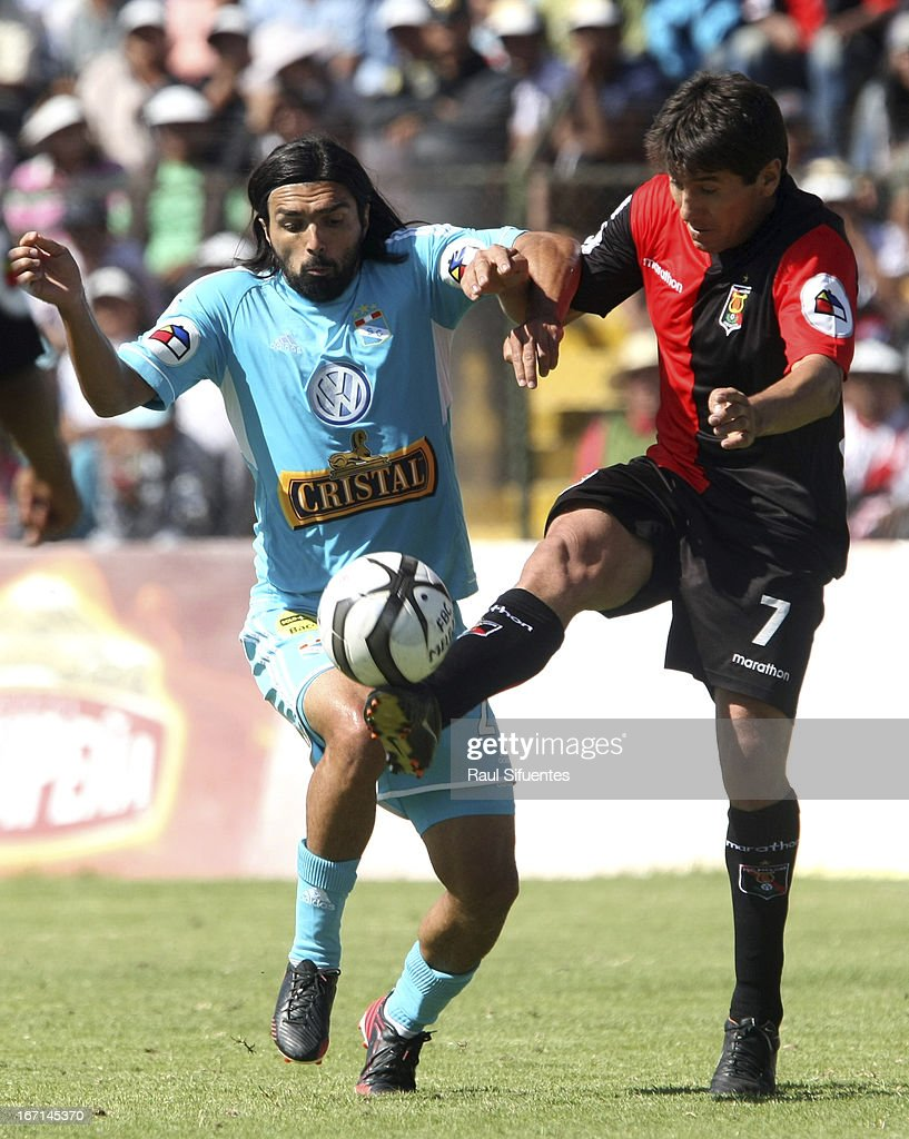 Jorge Cazulo (L) of Sporting Cristal fights for the ball with Larry Yanez (R) of Melgar FC during a match between Sporting Cristal and Melgar FC as part of the Torneo Descentralizado 2013 at the Mariano Melgar Stadium on April 21, 2013 in Arequipa, Peru.