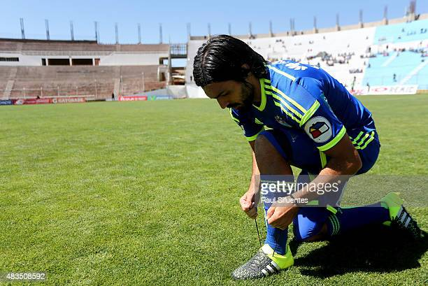 Jorge Cazulo of Sporting Cristal ties his boots before a match between Real Garcilaso and Sporting Cristal as part of 15th round of Torneo Apertura...