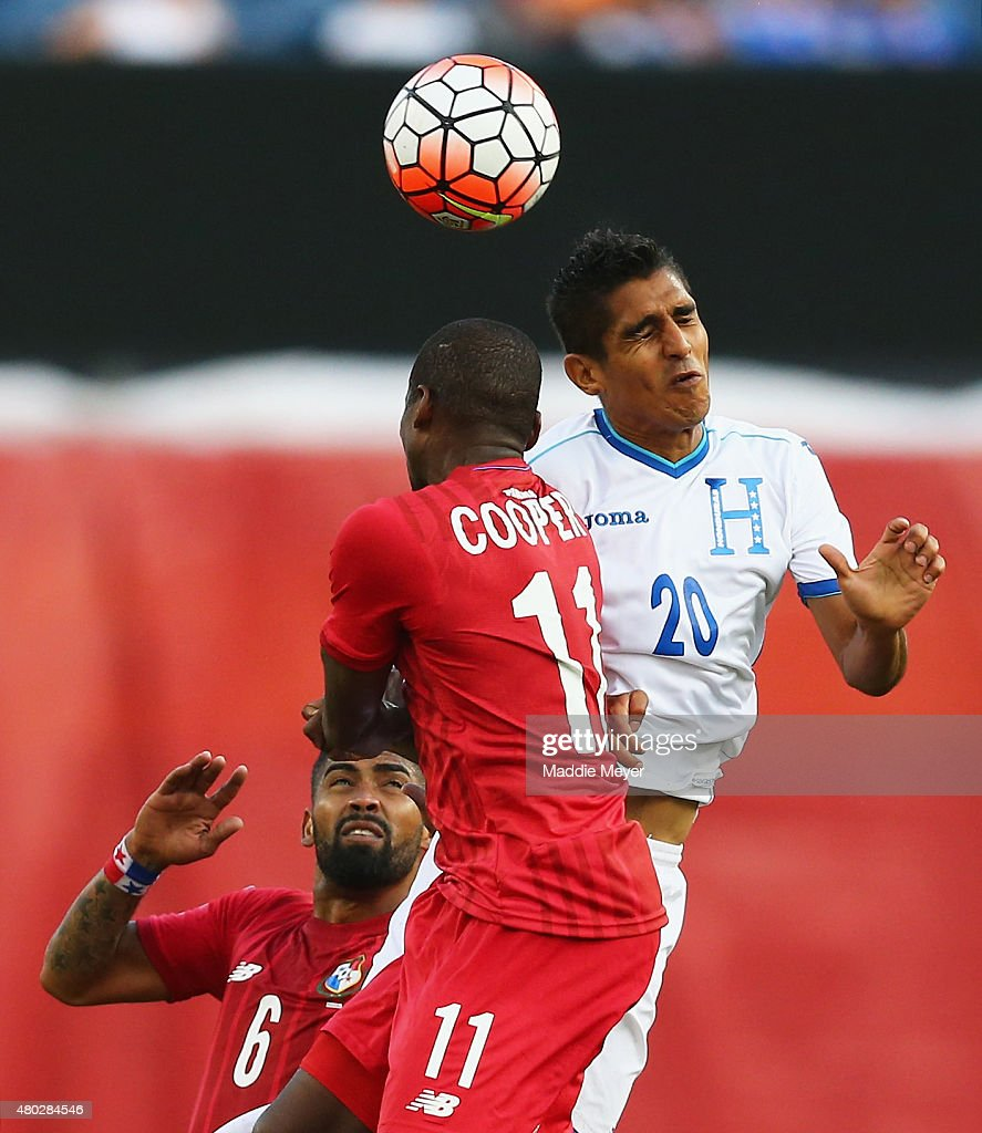 Jorge Claros #20 of Honduras Armando Cooper #11 of Panama and Gabriel Gomez #6 compete for a header during the 2015 CONCACAF Gold Cup match between Honduras and Panama at Gillette Stadium on July 10, 2015 in Foxboro, Massachusetts.