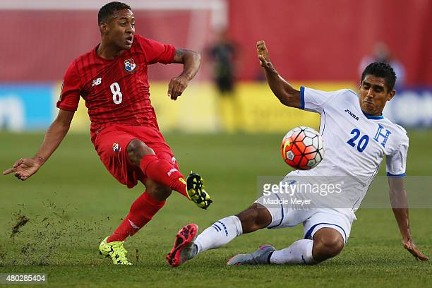 Jorge Claros of Honduras defends Gabriel Torres of Panama during the 2015 CONCACAF Gold Cup match between Honduras and Panama at Gillette Stadium on...