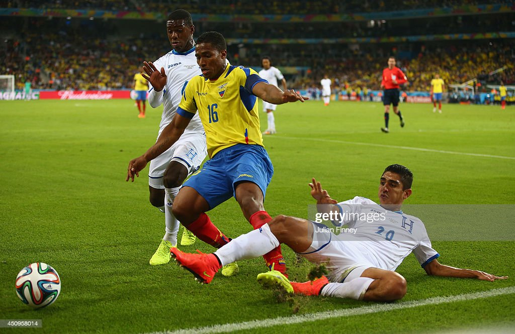 <a gi-track='captionPersonalityLinkClicked' href=/galleries/search?phrase=Jorge+Claros&family=editorial&specificpeople=4147533 ng-click='$event.stopPropagation()'>Jorge Claros</a> of Honduras tackles Antonio Valencia of Ecuador during the 2014 FIFA World Cup Brazil Group E match between Honduras and Ecuador at Arena da Baixada on June 20, 2014 in Curitiba, Brazil.