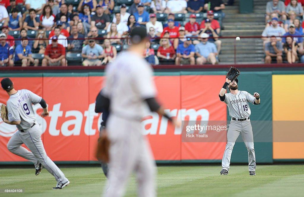 Jorge De La Rosa and Vinny Castilla react to Charlie Blackmon of the Colorado Rockies catching a hit by ShinSoo Choo at Globe Life Park in Arlington...