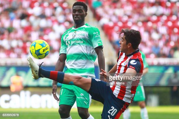 Jorge Djaniny Tavares of Santos and Rodolfo Pizarro of Chivas fight for the ball during the 5th round match between Chivas and Santos as part of the...