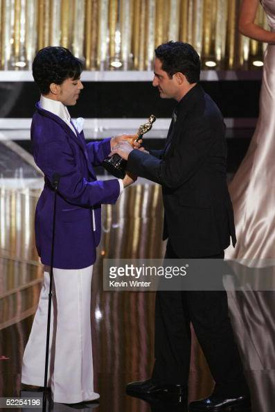 Jorge Drexler greets Prince after winning best original song for 'Al Otro Lado Del Rio' on stage during the 77th Annual Academy Awards on February 27...