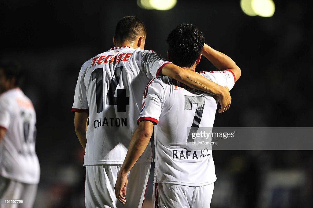 Jorge Enriquez congratulates Rafael Marquez during the match between Monterrey and Chivas as part of the Clausura 2013 on February 9, 2013 in Monterrey, Mexico.